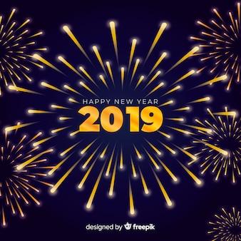 Priorità bassa dorata del nuovo anno dei fuochi d'artificio