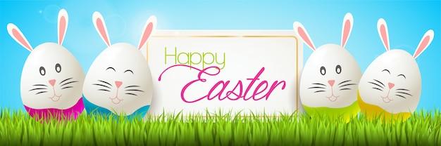 Priorità bassa felice di pasqua con le uova di pasqua sveglie del coniglietto