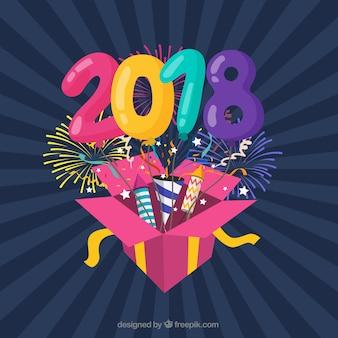 Priorità bassa piana variopinta di nuovo anno con un contenitore di regalo