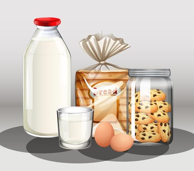 Prodotti da forno con bottiglia di latte e due uova in un gruppo