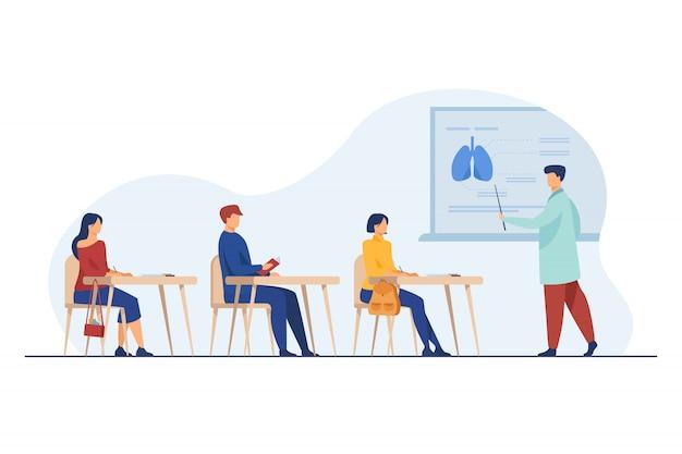 Professore medico che presenta al pubblico le infografiche degli organi