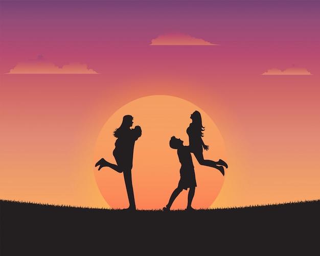 Profili i giovani felici della priorità bassa di tramonto