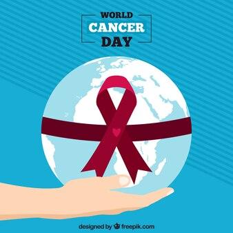 Progettazione del giorno del cancro del mondo con il globo della tenuta della mano