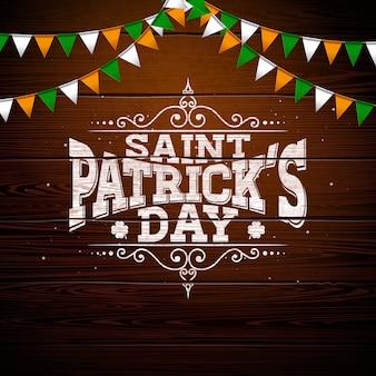 Progettazione del giorno di san patrizio con la bandiera nazionale di colore e la lettera di tipografia su fondo di legno d'annata.