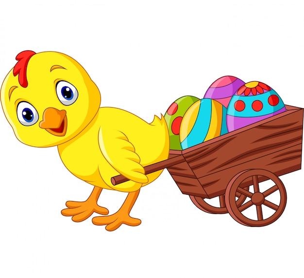 Pulcino del fumetto che tira un carrello pieno di uova di pasqua