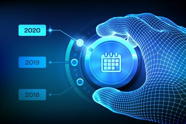 Pulsante della manopola dei livelli del calendario di impostazione della mano di wireframe sulla posizione per l'anno 2020.