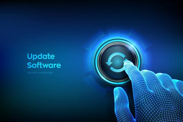 Pulsante di aggiornamento. dito del primo piano per premere un pulsante. aggiorna il concetto di versione del software.