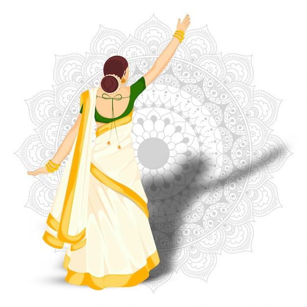 Punto di vista posteriore della donna indiana che sta nella posa alla moda sul fondo del modello della mandala.
