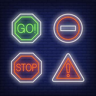 Punto esclamativo, vai e ferma le insegne al neon del traffico impostate