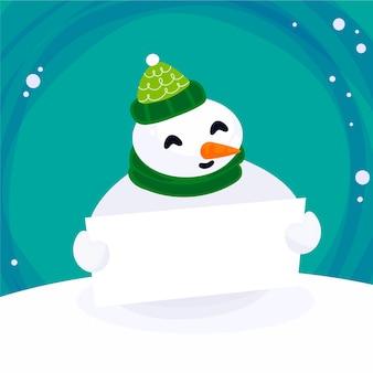 Pupazzo di neve di natale che tiene bandiera in bianco