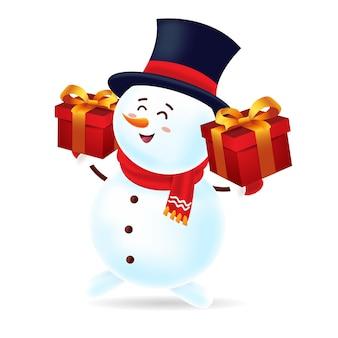 Pupazzo di neve felice con la sciarpa black hat e rossa che trasporta due contenitori di regalo con isolato