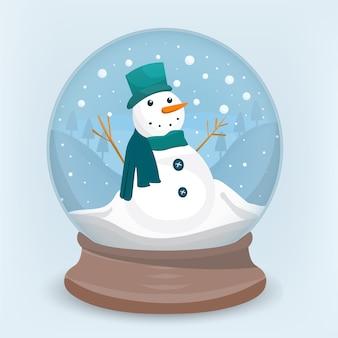 Pupazzo di neve felice dentro la sfera di cristallo