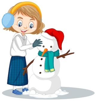 Pupazzo di neve manking della ragazza sull'isolato su