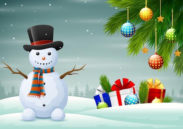 Pupazzo di neve sveglio con i contenitori di regalo sul natale di inverno