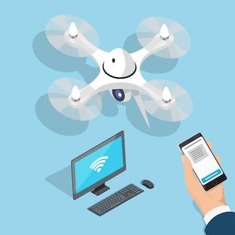 Quadcopter volante, computer, mano dell'uomo con il telefono