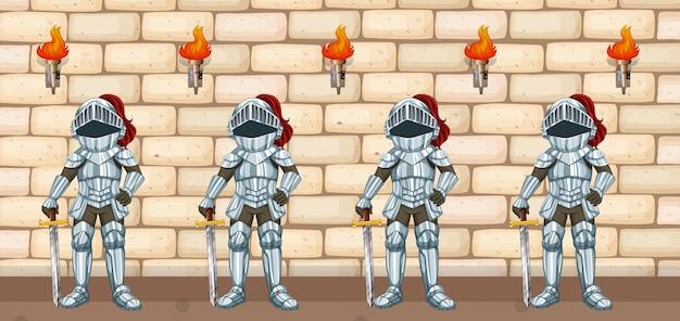 Quattro cavalieri in piedi al muro del castello