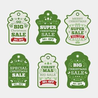 Raccolta dell'etichetta di vendita di natale nella progettazione piana