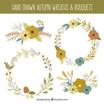 Raccolta delle corone autunno d'epoca e mazzi di fiori