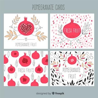 Raccolta di carte di melograno e foglie