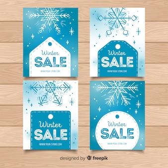 Raccolta di carte di vendita inverno di etichette e fiocchi di neve