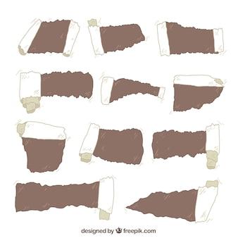 Raccolta di documenti strappati con diversi disegni