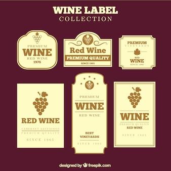 Raccolta di etichette di vini d'epoca in design piatto