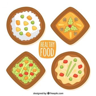 Raccolta di quattro piatti disegnati a mano
