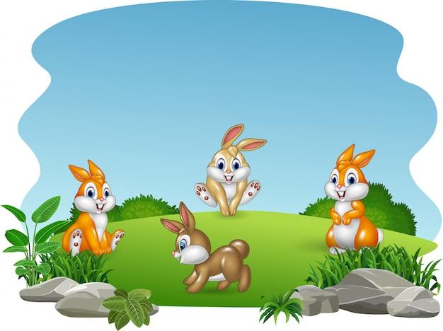 Raccolta felice dei conigli del fumetto con il fondo della natura