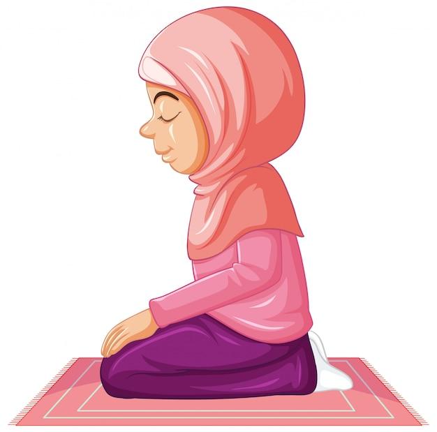 Ragazza araba in abbigliamento tradizionale rosa nella posizione di preghiera su fondo bianco