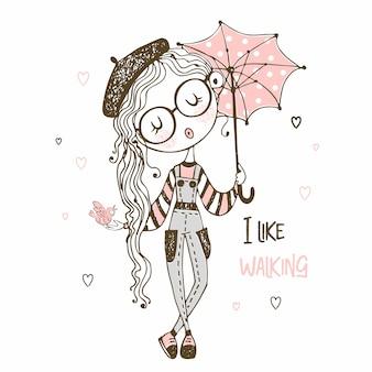 Ragazza carina con ombrello a piedi