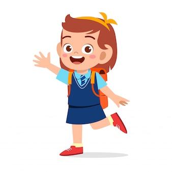 Ragazza carina felice pronta per andare a scuola