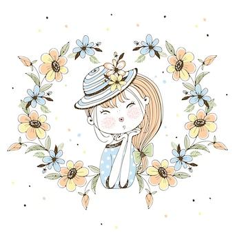 Ragazza carina in un cappello in una cornice di fiori.