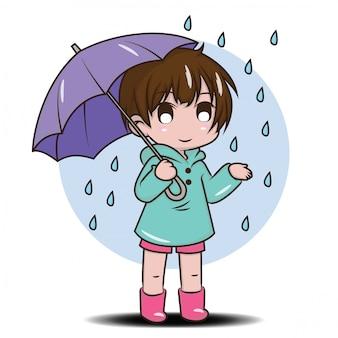 Ragazza carina per essere felice nella stagione delle piogge