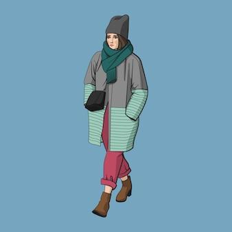 Ragazza che cammina in cappotto caldo