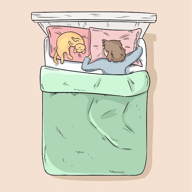 Ragazza che dorme pacificamente nel suo letto con il suo gatto.