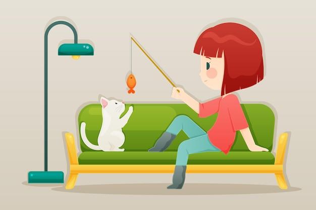 Ragazza che gioca con la sua illustrazione del gatto