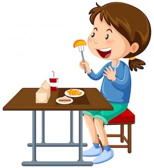 Ragazza che mangia al tavolo da pranzo mensa
