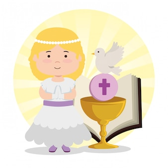 Ragazza con calice e bibbia alla prima comunione