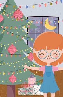 Ragazza con i regali dell'albero e le luci buon natale di celebrazione del salone