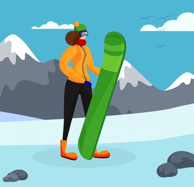 Ragazza con lo snowboard in posa sullo sfondo di montagne