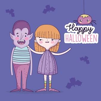 Ragazza e ragazzo felici di celebrazione di halloween con i ragni dei pipistrelli e dei costumi