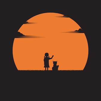 Ragazza e un cane su uno sfondo tramonto