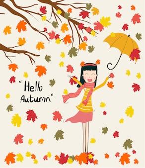 Ragazza felice che gode delle foglie variopinte di caduta