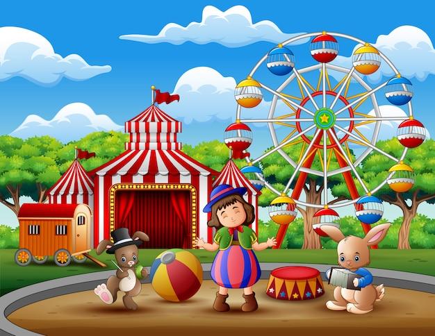 Ragazza felice in costume con un circo di conigli nell'arena
