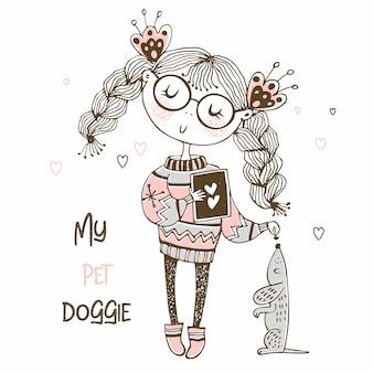 Ragazza in un maglione che gioca con un cane il bassotto.