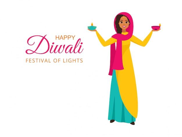 Ragazza indiana in abiti nazionali tiene accese le lampade per il festival delle luci con un augurio di felice diwali