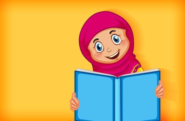 Ragazza musulmana che legge il libro