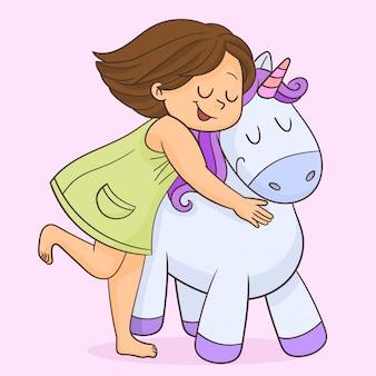Ragazza sorridente con il suo unicorno