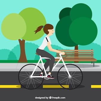 Ragazza su una bicicletta in fondo design piatto