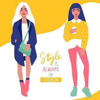 Ragazze alla moda in vestiti alla moda isolati